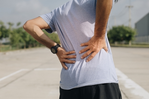 Muscle or ligament strains can cause a stiff back.